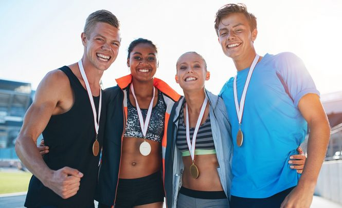 Finishers Wearing Race Medals