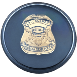 State Police Badge in Display Case